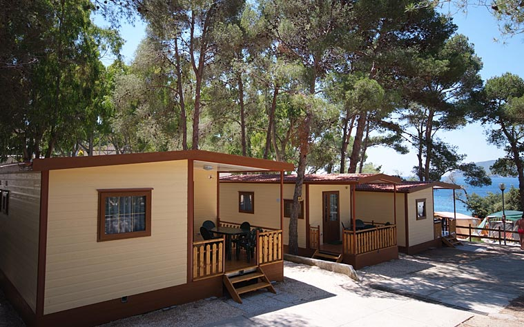I bungalows sul mare camping village le calanchiole for Bungalow spiaggia